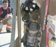 Baytown firefighter performing the wall breach escape maneuver