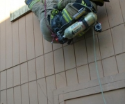 Baytown firefighter just after bailing out a window during the emergency rope escape evolution
