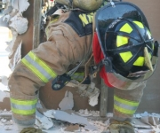 Firefighter completing the emergency wall breach escape in Baytown Texas